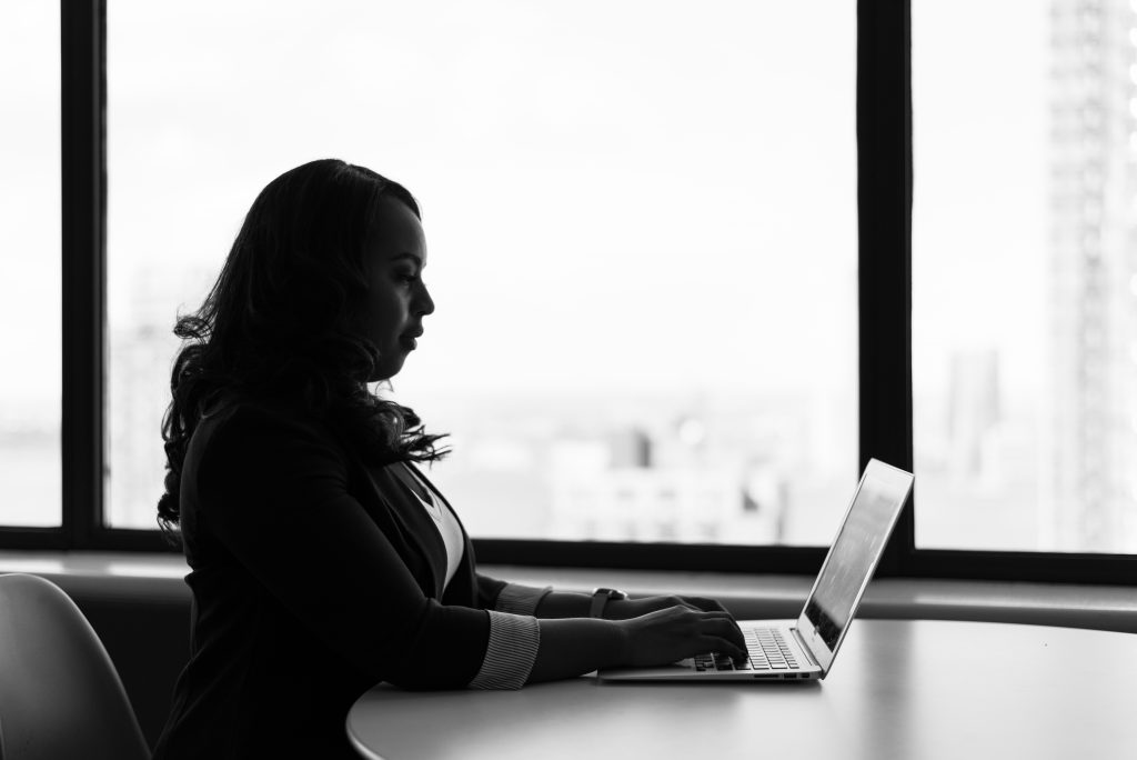 Canva - Grayscale Photography of Woman Using Laptop